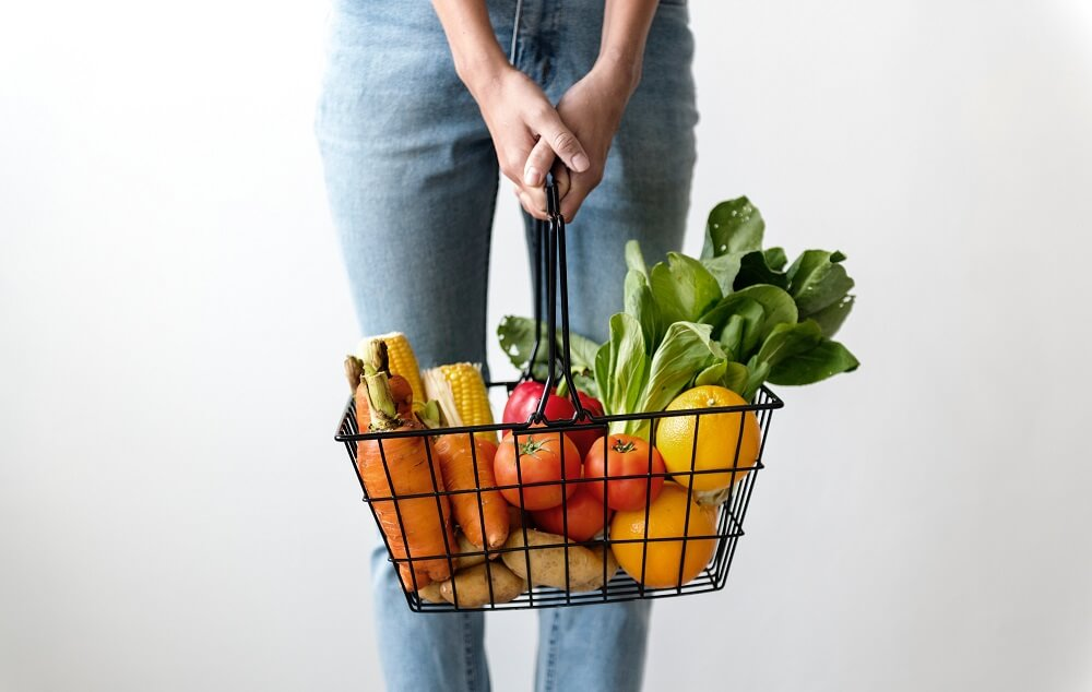 woman holding vegetables
