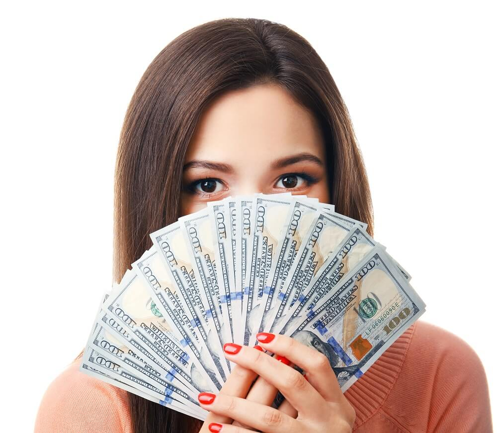 woman holding hundred dollar bills