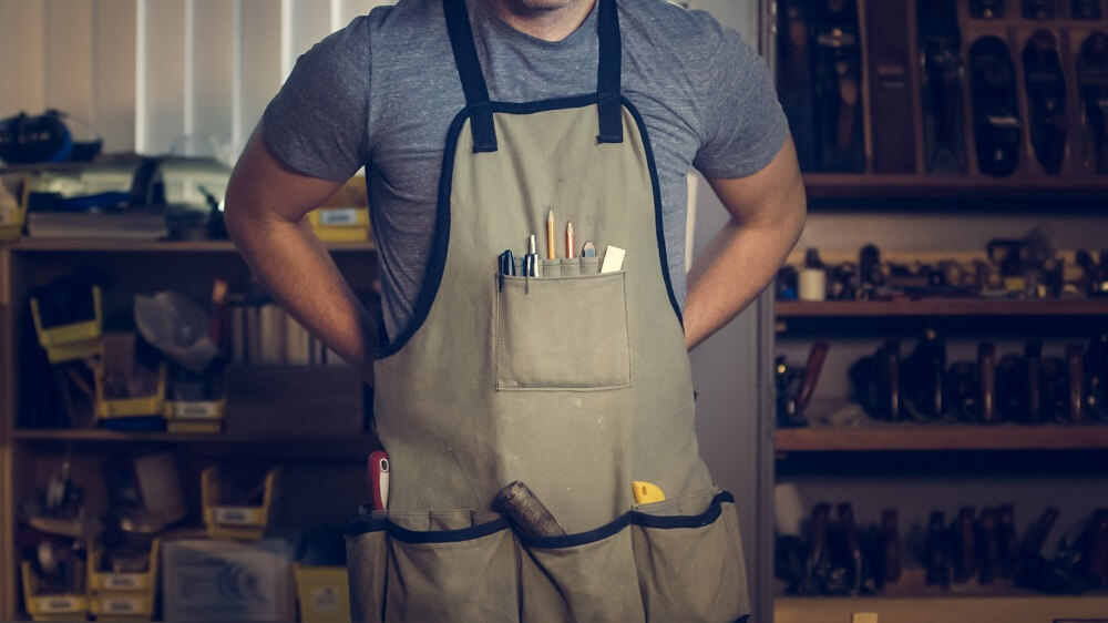 man with tool apron on