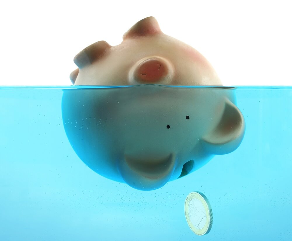 piggy bank upside down in water