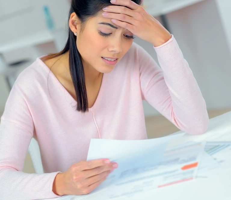 woman who is tired of struggling financially