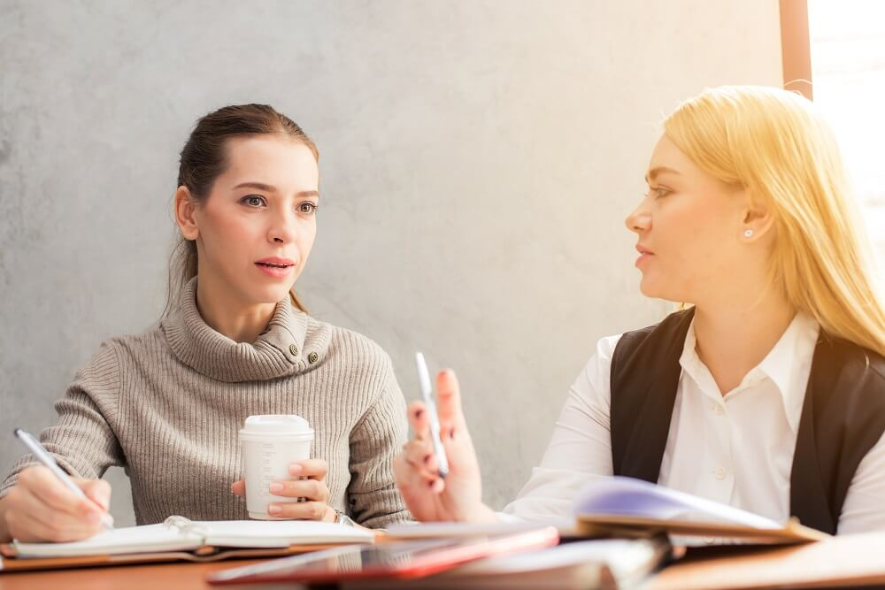 two women having business meeting