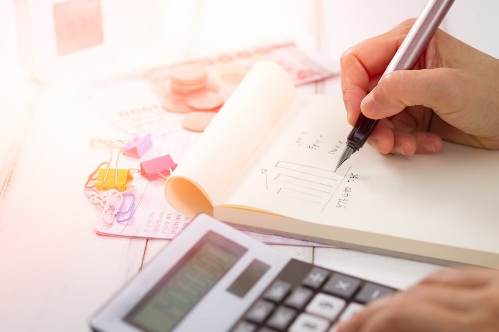 man writing his budget