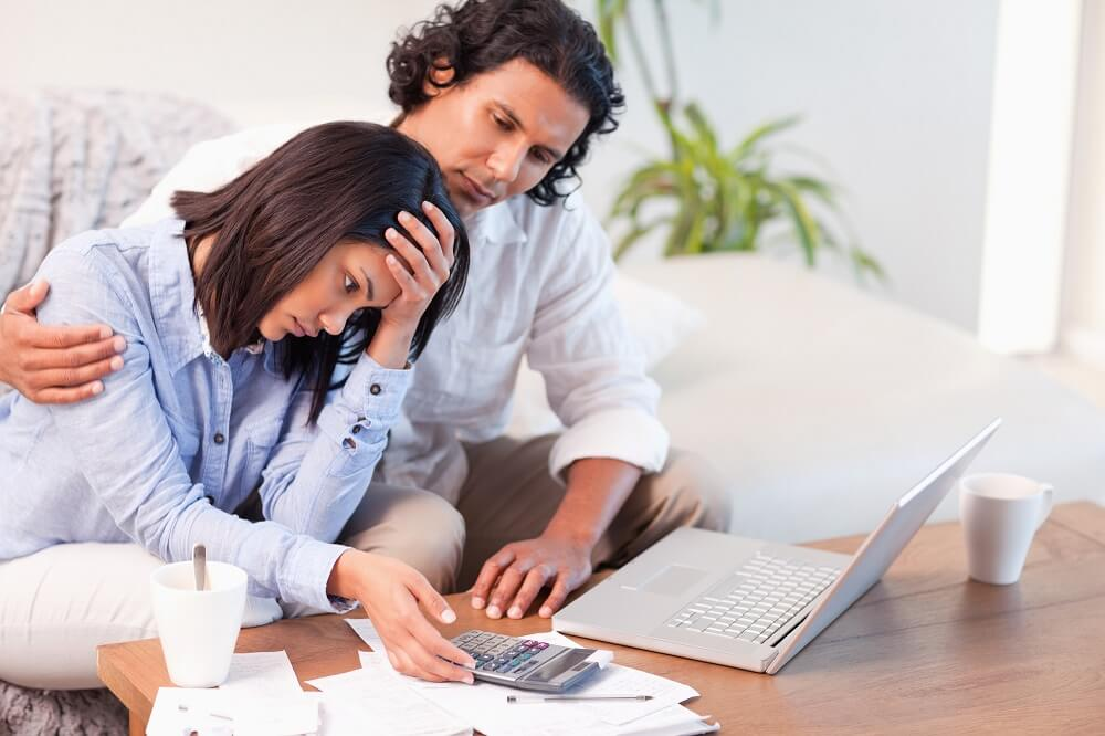 couple stressed over financial mistakes