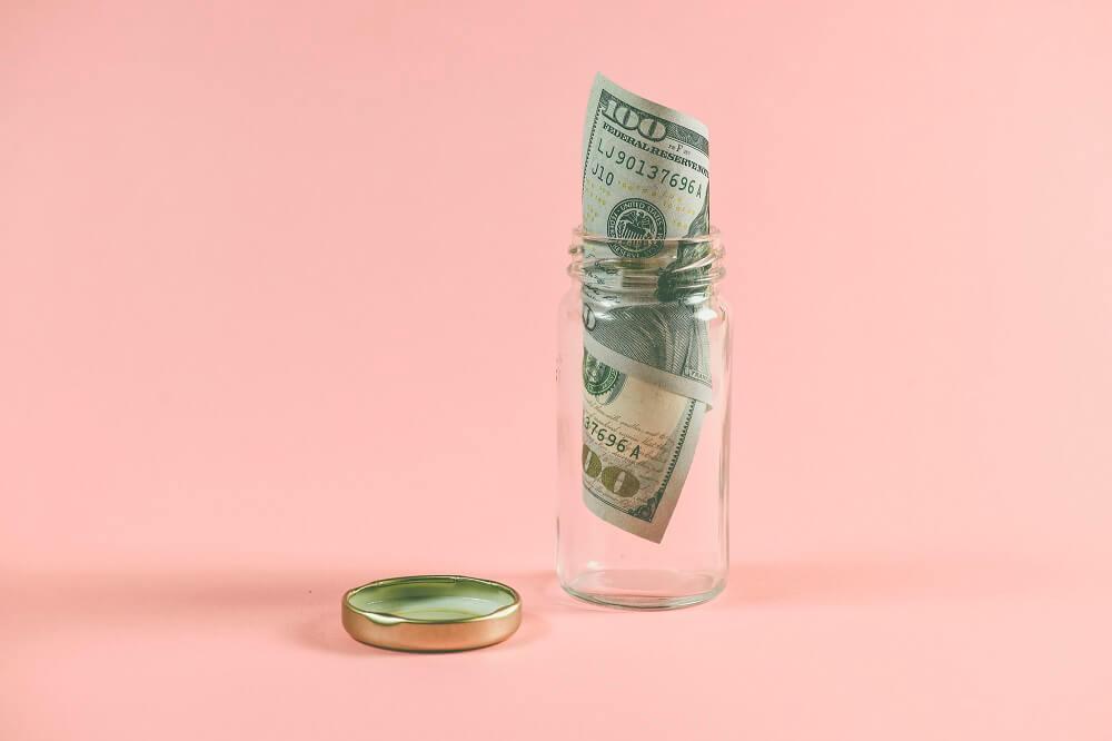 hundred dollar bill in jar