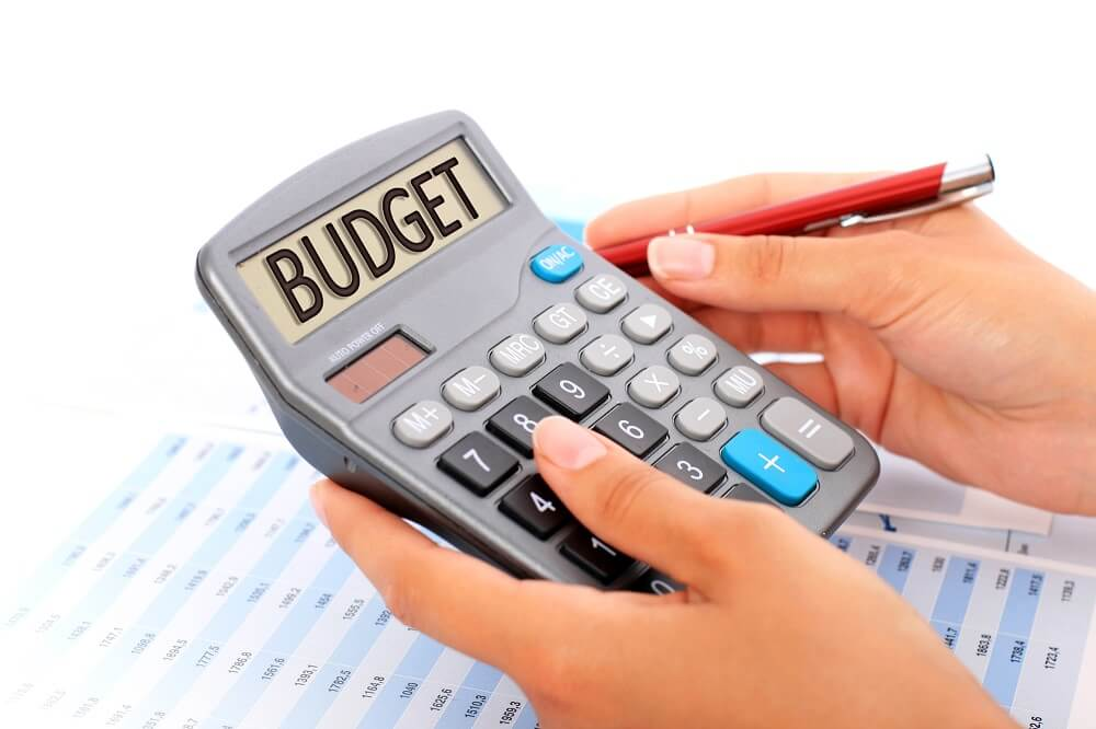 woman budgeting with calculator