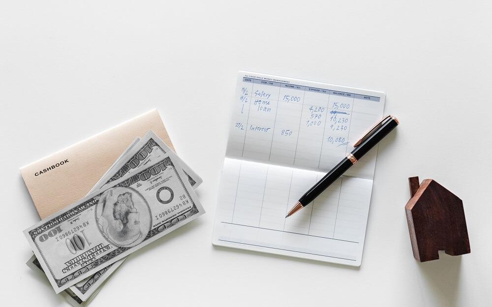 checkbook and dollar bills