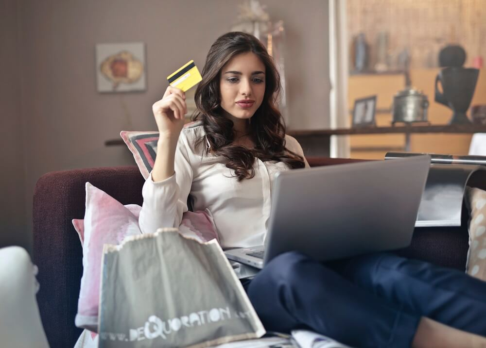 woman using credit card to shop online