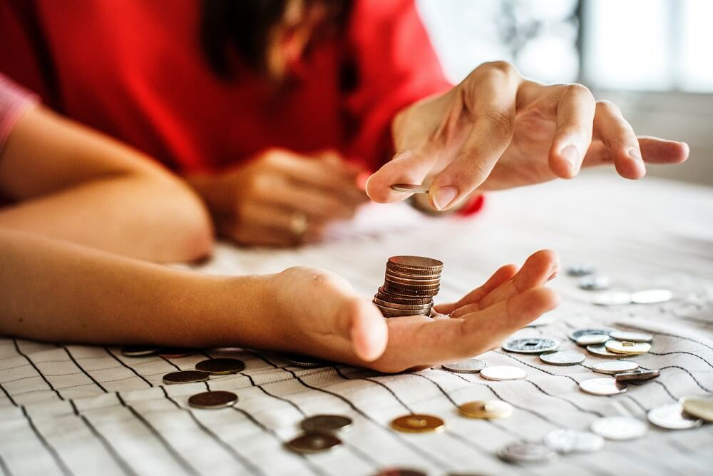man and woman counting coins