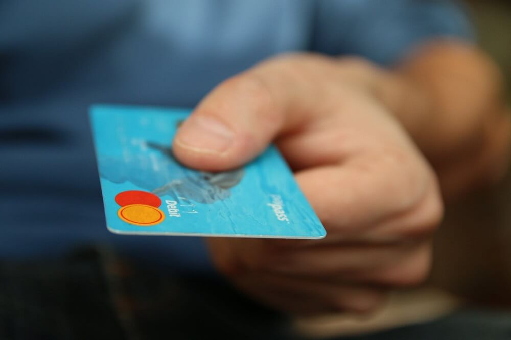 man holding credit card