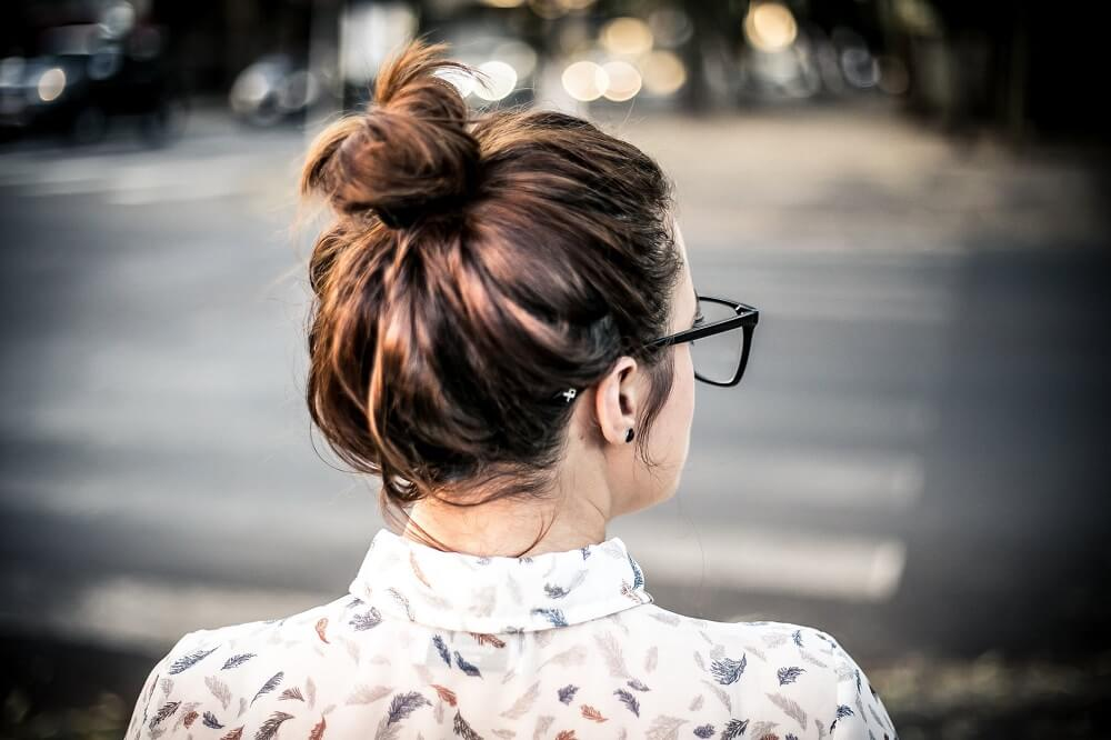 back of womans messy bun