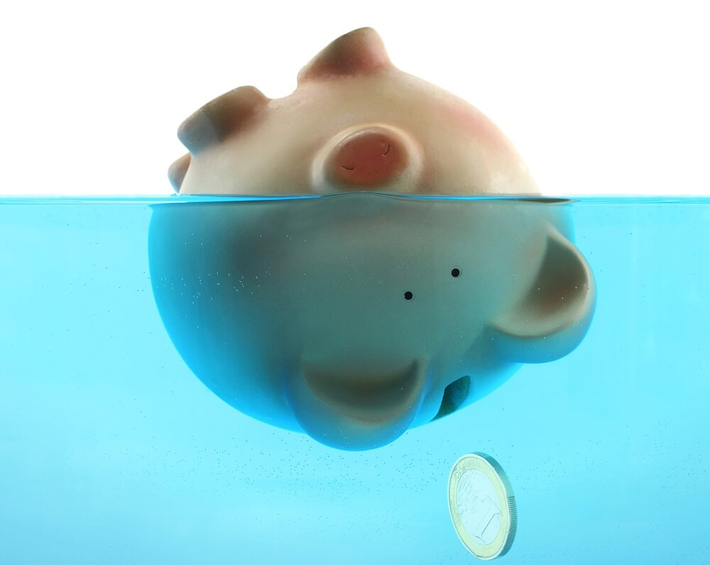 piggy bank dumped in water