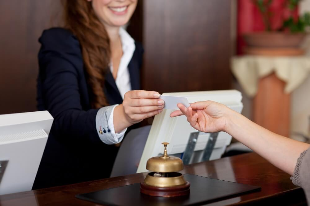 woman checking in at hotel
