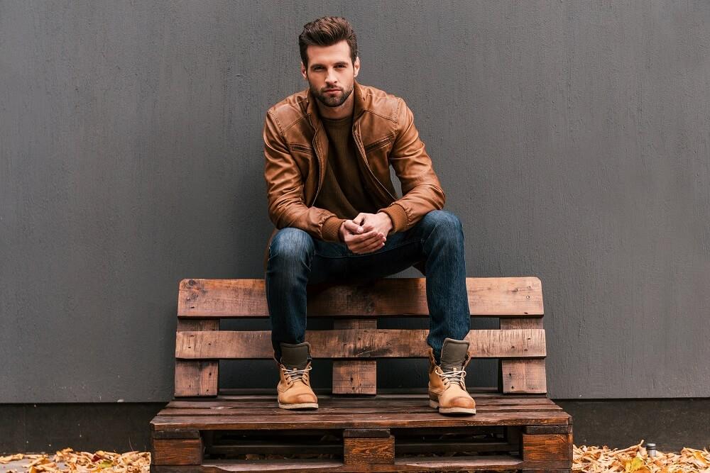 attractive man sitting on bench