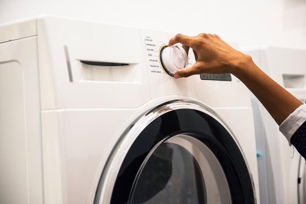 woman using washing machine