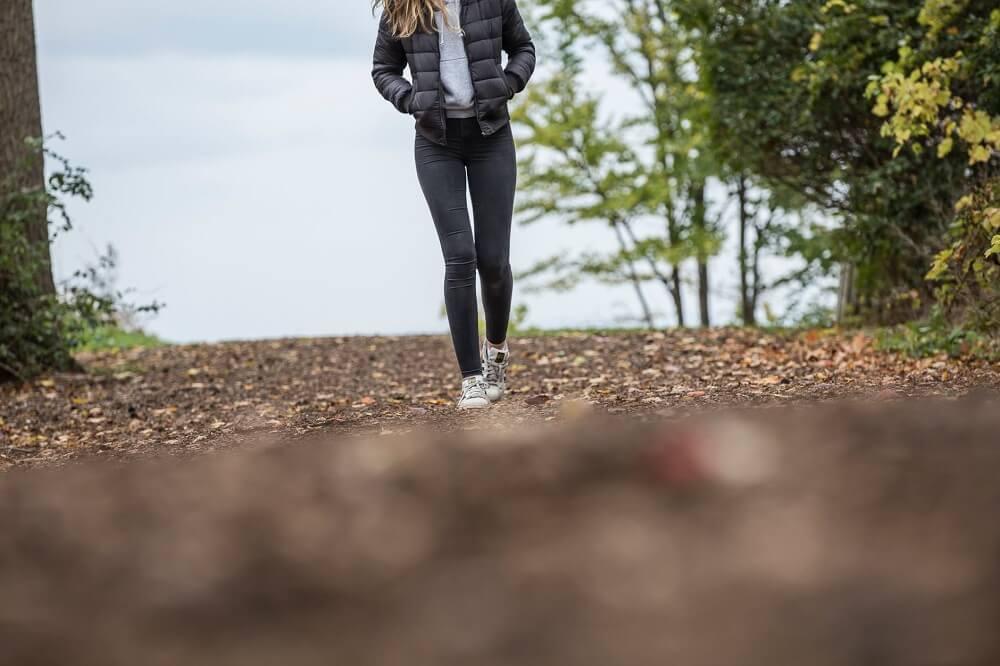 woman walking alone in woods