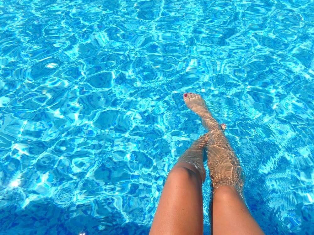womans legs in pool