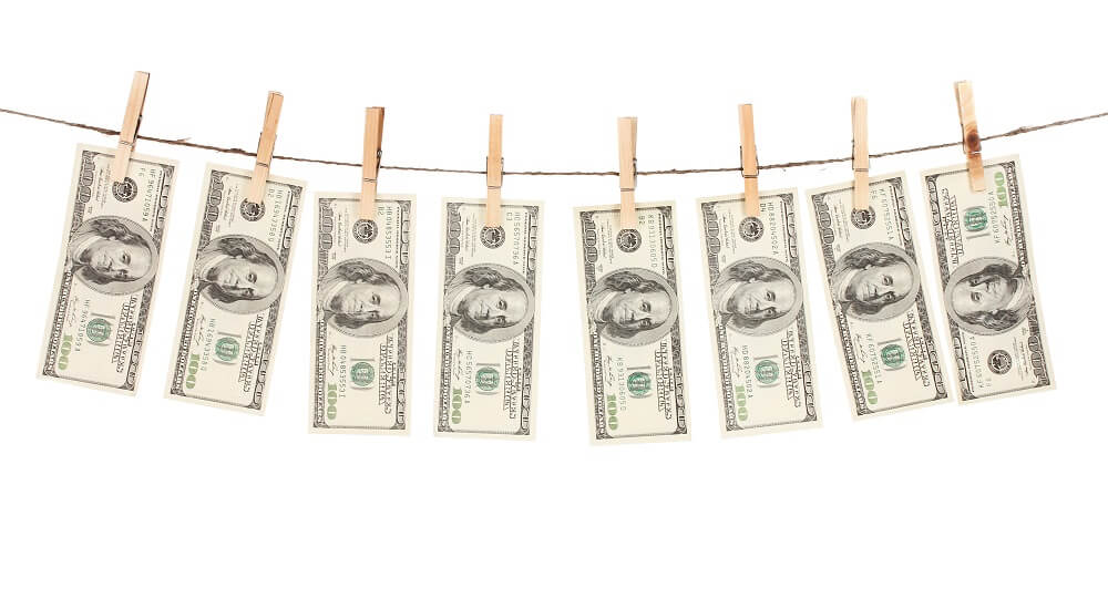 money hanging from clothes lines