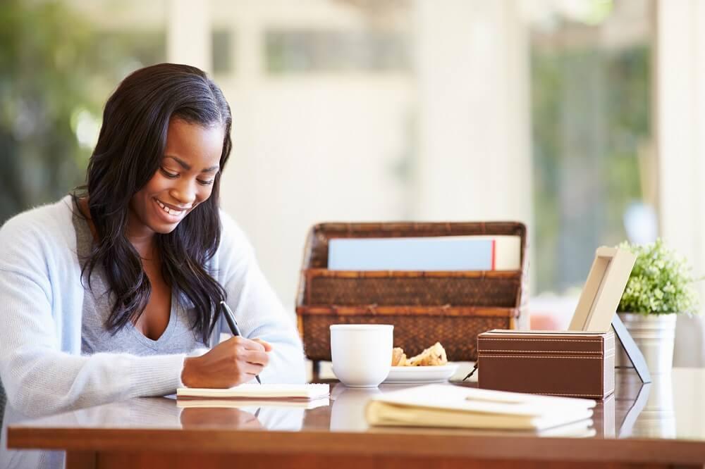 woman budgeting using cash envelopes template