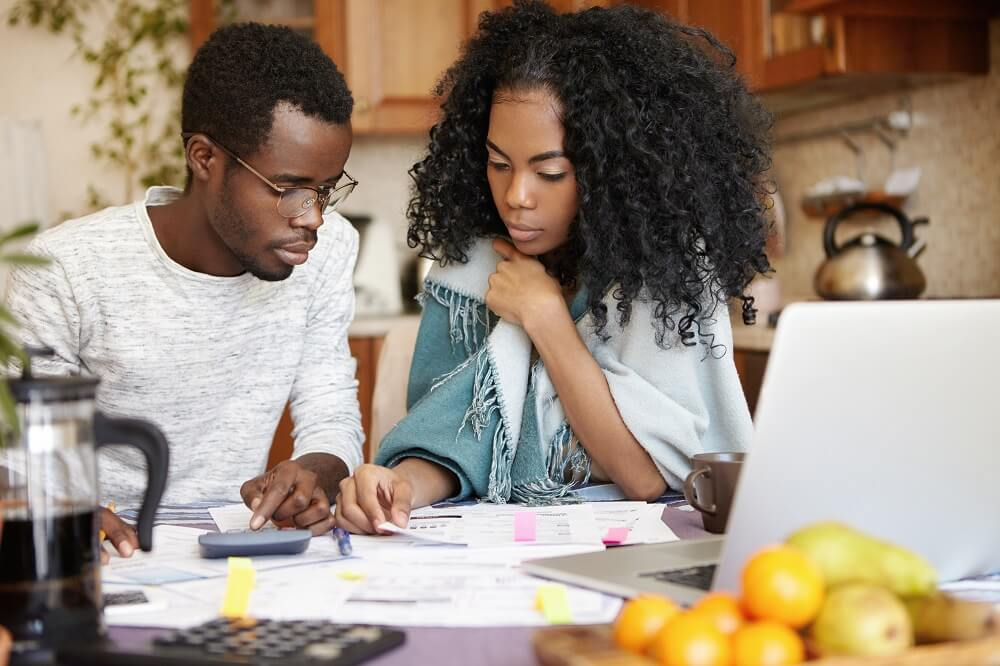 couple budgeting as one of their debt reduction strategies