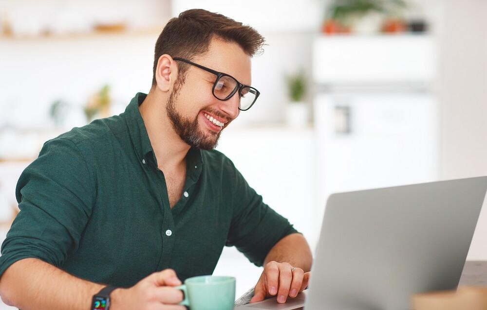 man using laptop for debt reduction strategies