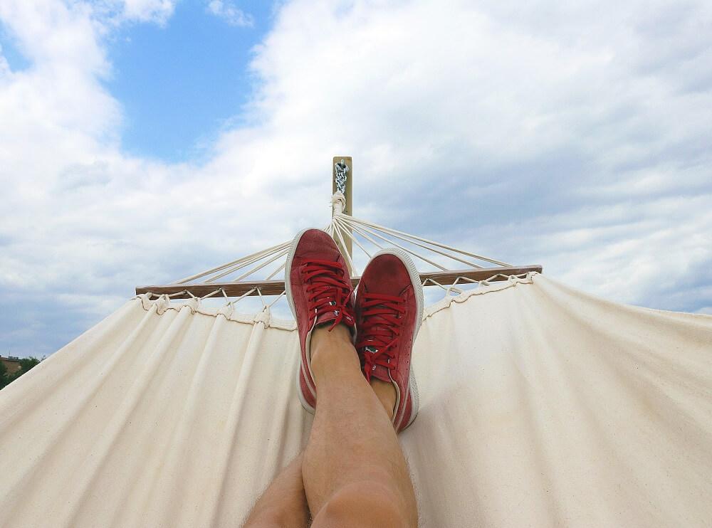 man sitting in hammock