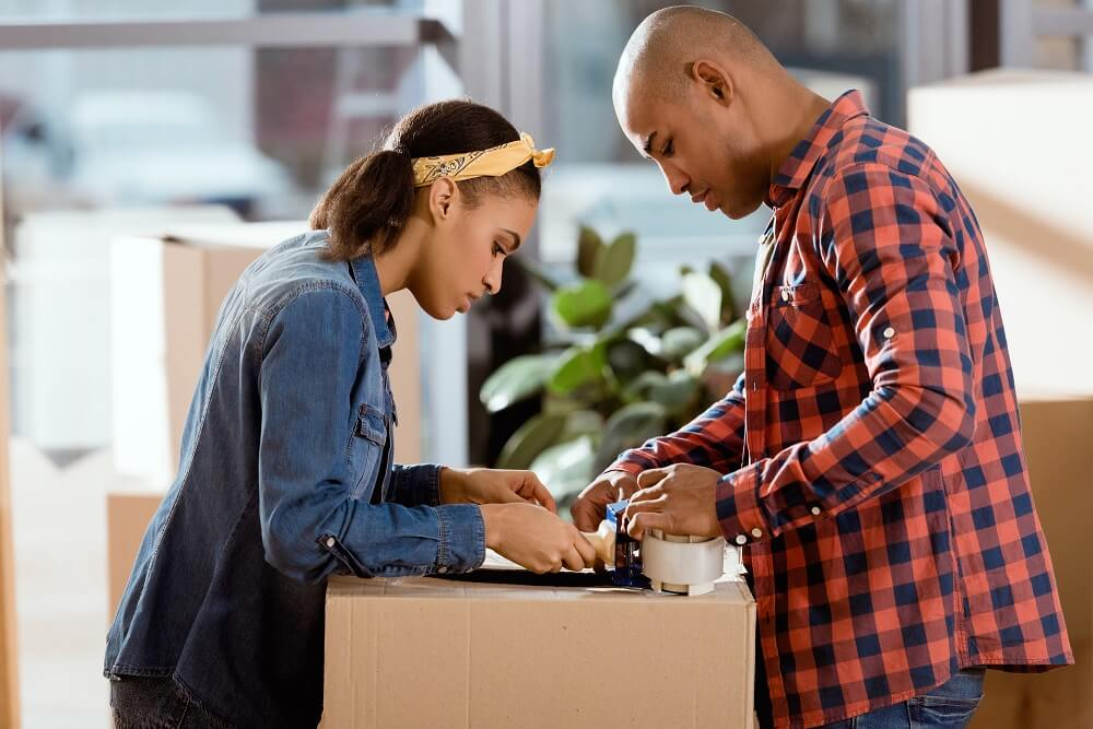couple packing up a box