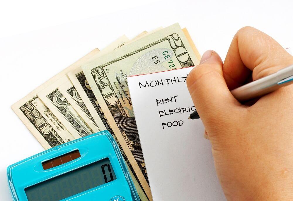 man writing budget for cash envelopes template