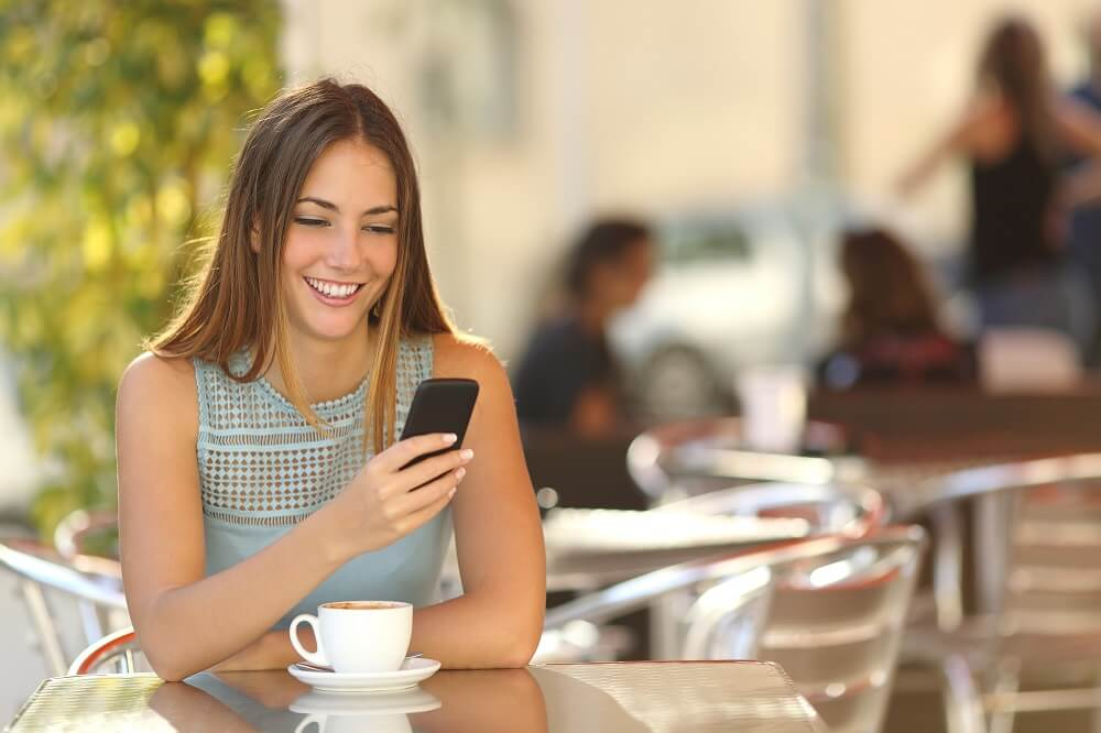 woman using her cellphone for smart money making moves