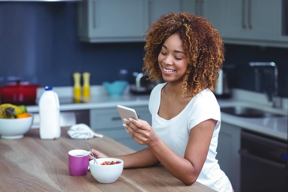 woman using cellphone to make smart money making moves