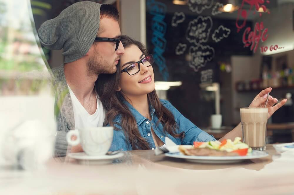 couple hugging in cafe - sex tips for men