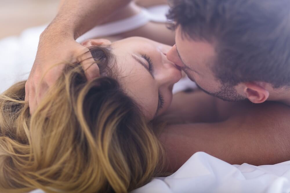 couple kissing in bed - sex tips for men
