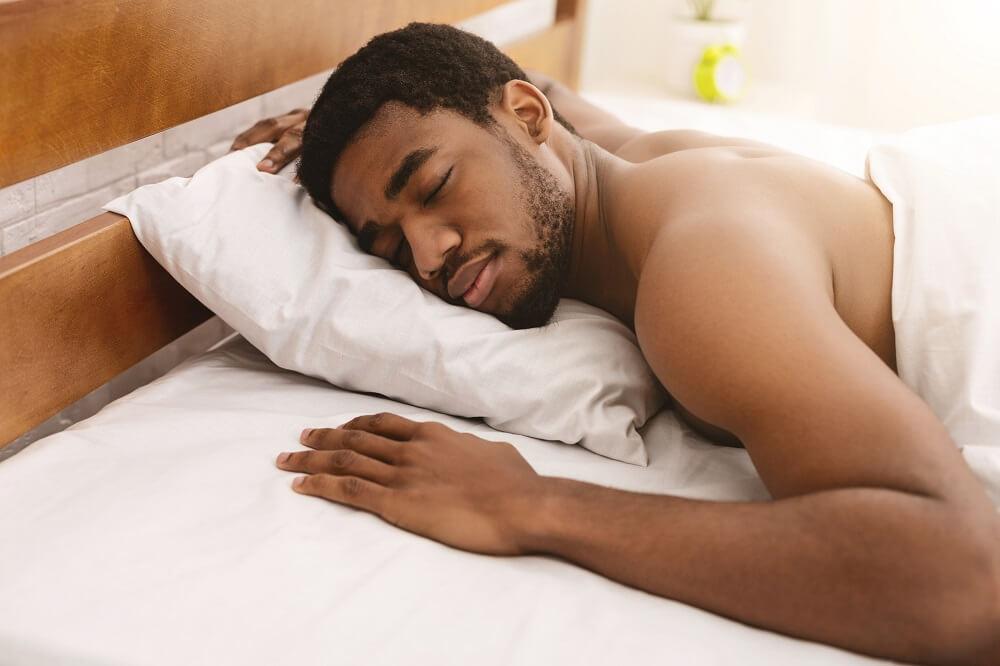 man asleep in bed - sex tips for men
