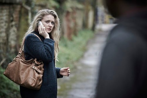 woman walking alone looking scared