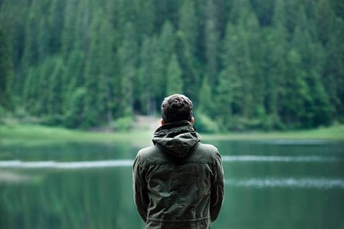 man looking out over water